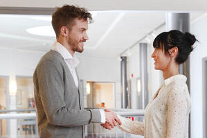 Svar-Life-Science-two-business-people-shaking-hands-after-negotiating-business-in-scandinavian-style-office